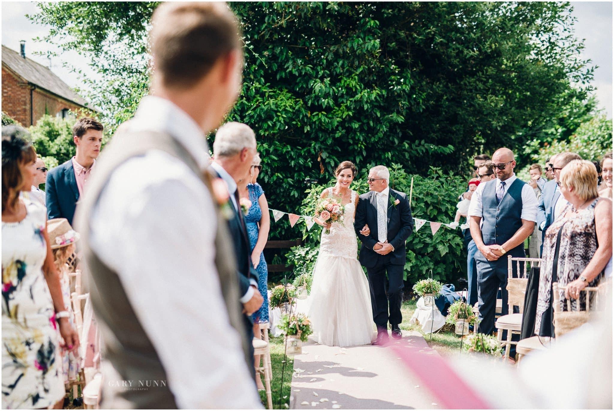 unplugged wedding, bride walking down the isle