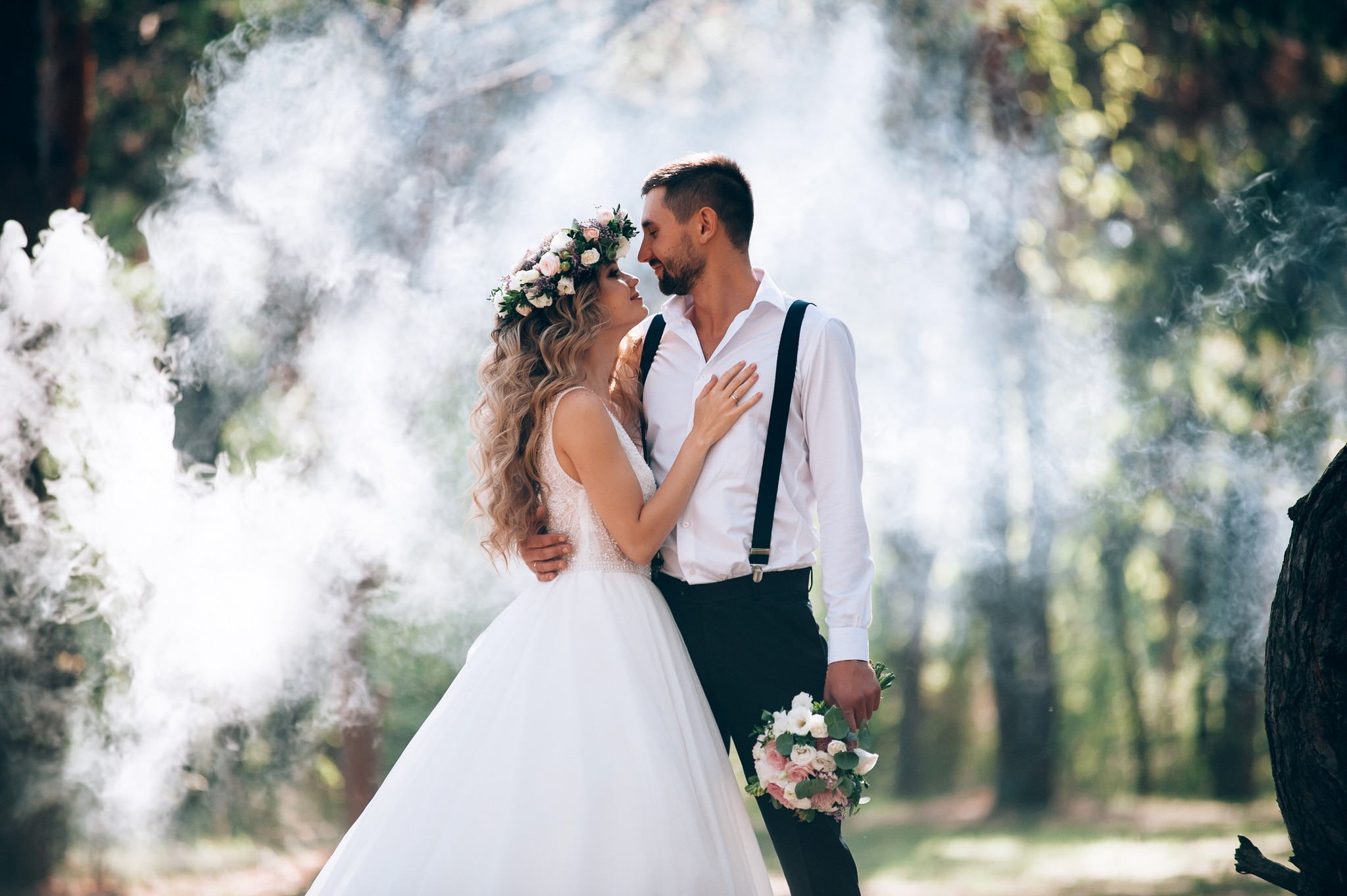 bride and groom on the background of fairy fog in the forest. Ru